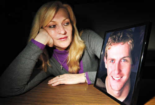 Cherrie Cran with a photo of her son Bede.