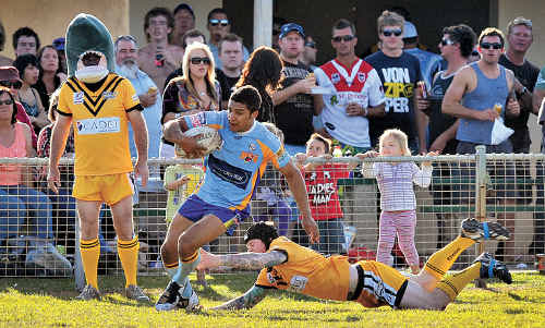 Not quite: Gympie's Ben Ashford escapes a would-be tackler.
