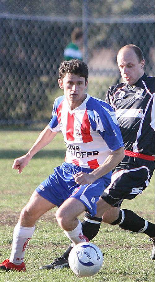 Raiders midfielder Rubens Borges tries to evade an Ipswich City defender yesterday.