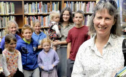 Over the moon: Karen McDonald stands in the current Grafton library with her kids who are home-schooled and borrow over 40 books a fortnight from the current library.