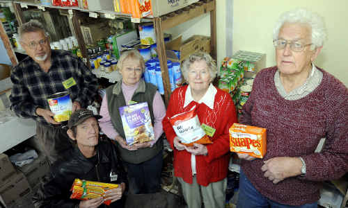 Seeking help: Volunteers at the Casino Food Cupboard (from left) Neville Wynne, Peter Gee, Dorothy Rees and Norma and Eric Pearce get ready for another busy day of providing food to the needy.