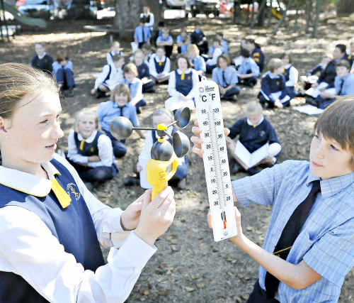 Warm and sunny: Clarence Valley Anglican School students, Shannon McFarlane and Angus Woods, take a reading.