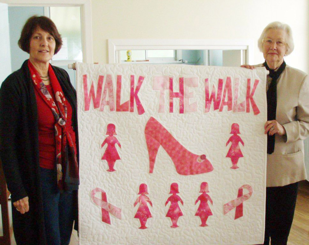 Betty Dengate (right) and Elizabeth Casimir with the quilt.