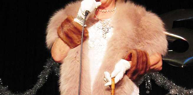 Pam Sullivan sings at the extravaganza.