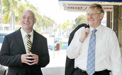 Chris Trevor and Federal Resources Minister Martin Ferguson walk down Goondoon Street in Gladstone yesterday.