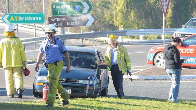 A father and baby were uninjured in a collision with a timber truck near the Normanby overpass.
