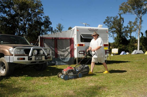 Shane 'Buttsy' Butler from Woongoolba, south of Brisbane, works up a thirst at the Muster mowing his neighbours' campsite.