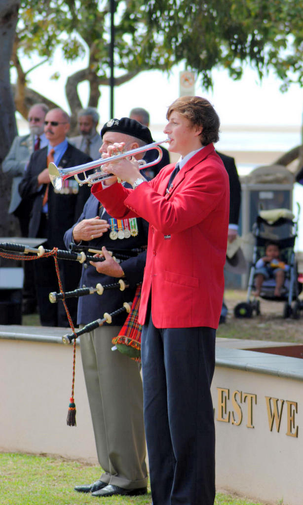 Bugler Callum Beutel from St Andrew's Anglican College at the Vietnam Veterans Day.