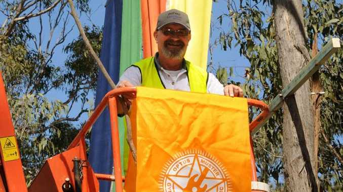 Ian Bayne keeps the Muster signage going up at the Muster site.