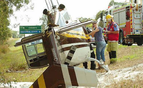 A helicopter made an emergency landing next to the Bruce Highway.
