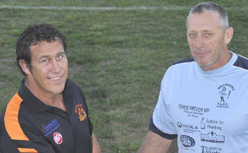 SHAKE ON IT: Wallabys' coach Danny McAllister, left, Mark Graham Brothers Coach at Marley Brown Ova, Gladstone.