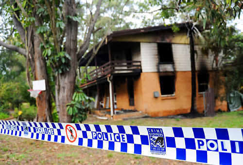 Fire destroys a two storey house on Samuels Road yesterday.