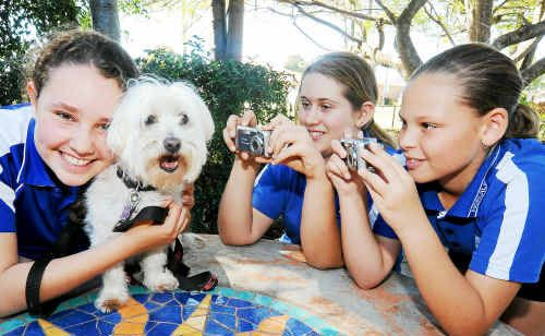 Norville State School students Anna Duffy, Jordon Marsh and Kaitlyn Bunn are all set to enter the Your Best Pet Picture competition.