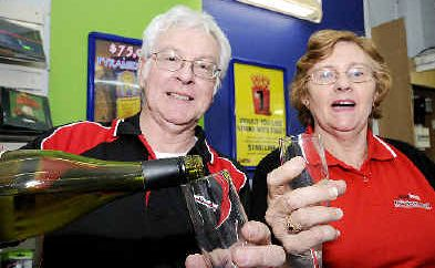 Here's cheers: Barker Street newsagents John and Wendy Lane celebrate selling the winning $1 million Lotto ticket at their Casino newsagency.