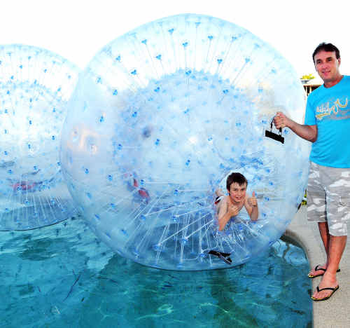 Graham Young and his son Samuel with their Zorb Balls.