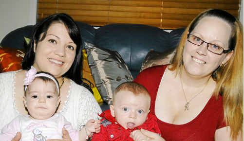 Eleni Meyrick with her daughter Isabella, 5 months and Michelle Moore with her son Jack, 6 months.