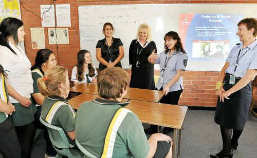 Kepnock State High School students listen to Maryborough Corrections Centre education officer Tammy Gregory, with Bundaberg Probation and Parole Office staff Sophie Dreise and Jann-Maree Mitchell, and education officer Felicity Murray.