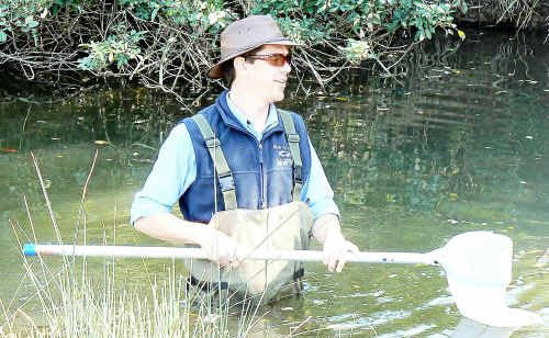 Dale Watson needed to wear waders to collect samples from the creek.