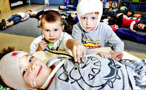 They're game: Wollongbar four-year-old preschoolers Kyran Urquhart-Warren (left), Harry Job and Jackson Ellem get into the theme of Injury and Illness Day to help raise money for the Westpac Life Saver Rescue Helicopter. jay cronan