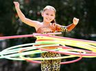 Eight-year-old Americus Wilson spins hula hoops as part of the Out of Africa Loritz Circus.