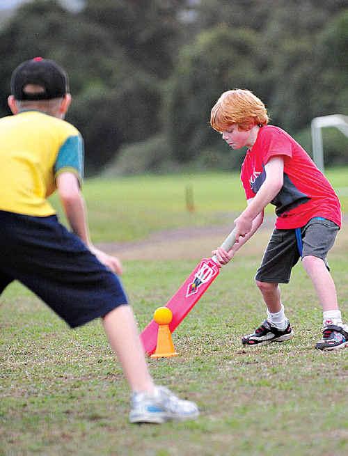 Jai Wilson, 7, tries his hand at the batting caper.