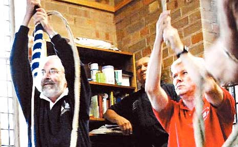Roped in: Chris Haller and Bruce Butler, two members of the North American Guild of Bellringers invited to St Andrew's Anglican Church to ring the bells during Monday's practice session.