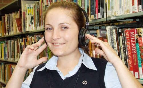 Maryborough library assistant Niomi Gilby is looking forward to the introduction of audio books that can be downloaded as audio files.