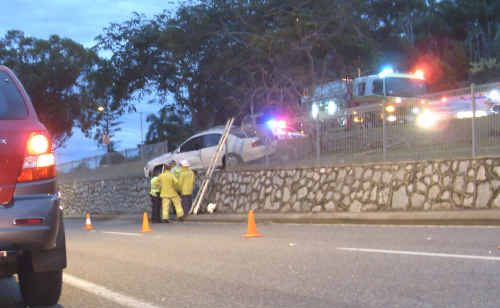 A vehicle ended up hanging over the island in an accident during the early hours of yesterday morning on Phillip Street, Gladstone.
