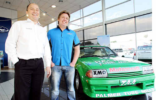 Dan Bowden and Greg Manchester celebrate 50 years of the Ford Falcon at Pacific Ford with Dick Johnston's 1984 XE touring car, Green Tuff.