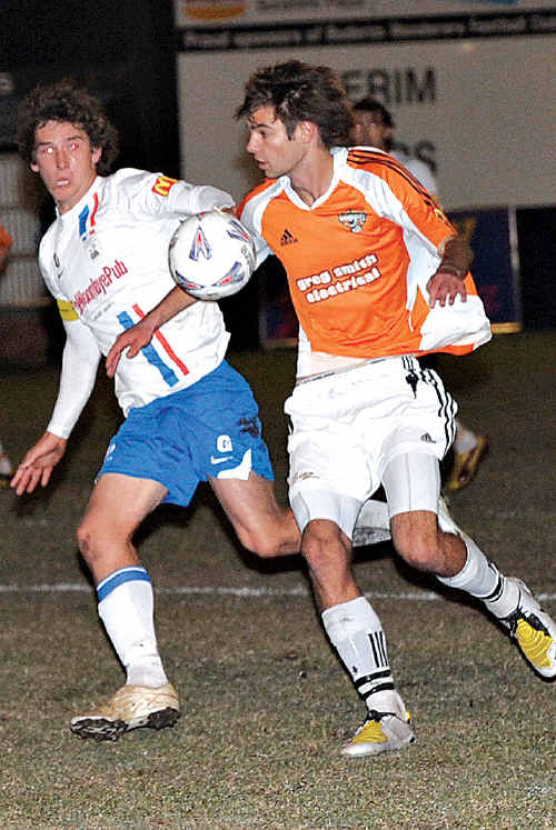 Woombye's Luke Alderson, left, and Buderim's Jackson Crickmore contest a ball during last Saturday's match.
