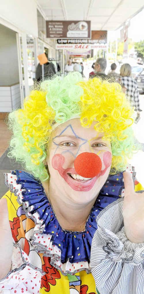 Kellee Marscham of ESP clowns will be around Prince Street on Crazy Day.
