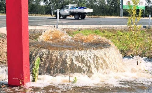 Water flowing freely from a burst mains pipe, part of the Fraser Coast's irrigation scheme, at the corner of Five Mile Road East and the Bruce Highway just south of Maryborough turnoff yesterday afternoon.