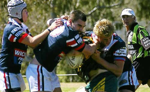 Warwick U18 trio Paul Cantwell, Luke Coombes and Shane Duck defend against Wattles in a Mick Ryan Trophy win.
