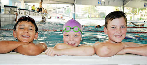 Tadpoles Brendan Hoffman, nine, Caitlin Skaines, eg, and Jonathan Skaines, 12, said chocolate and making friends were big ticks in their book for 100 years of Warwick Swimming Club.
