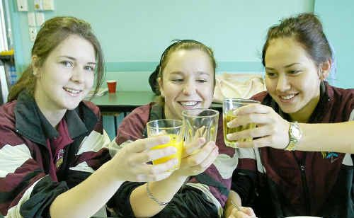 Tiffany Pieper, Brandi Young and Elisha Remana toast the start of the QCS tests.