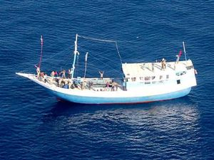 Asylum seeker boat crew member saved after 12 hours in water