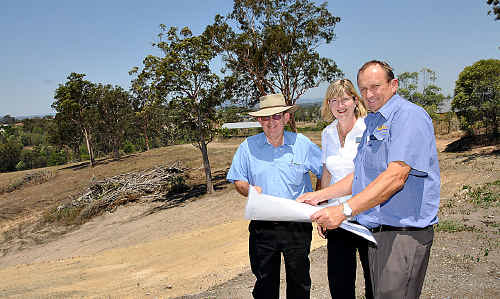 Gympie Regional Council Planning Committee chairman Ian Petersen (left) with developers Margaret and John Cochrane on the site of their Gympie retirement village project.