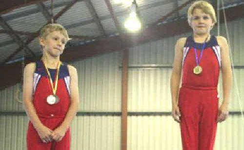 Gladstone Gymnastic Club MG Level 3 members Simeon Lockett and Joshua Hurst, right, receive their medals.