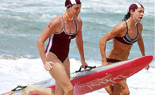 Karina Lee, left, and Jordan Mercer take out the under-17 female board rescue at the 2010 state surf lifesaving titles at Kurrawa.
