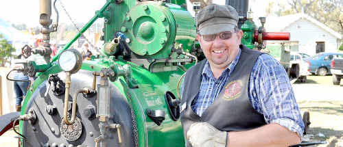 Warren Buckley and a portable steam engine at the Heritage Ag Show at the Toowoomba Showgrounds