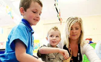 Big steps: SCU student Angela Hearn with youngsters Jayden and Dylan Tapfer.
