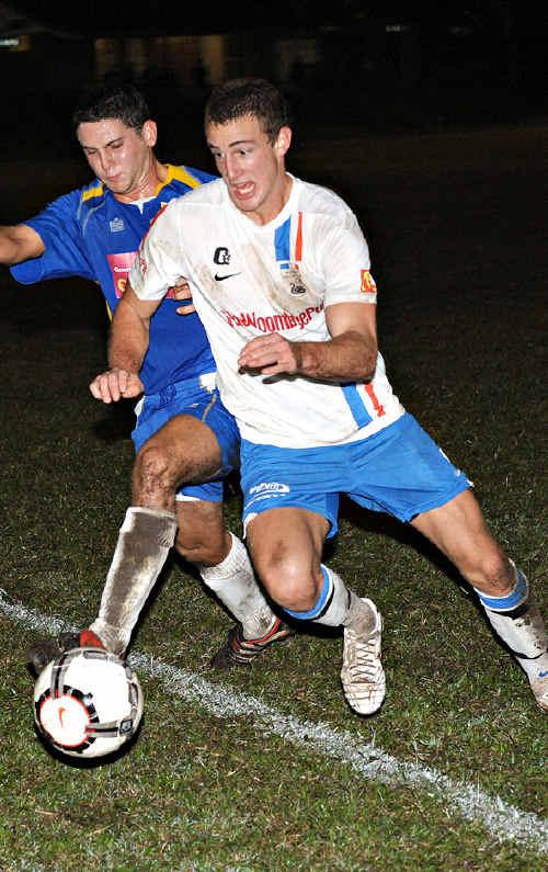 Noosa's Ben Cahn, left, contests possession.