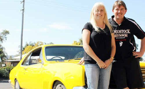 Monaro fans: Rose City residents Donna and Greg Sheather with their 1968 Monaro HK GDS which will zoom down the track at Morgan Park this Sunday.