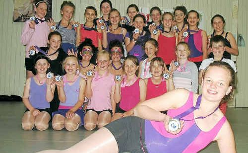 Prize dancers: Killarney School of Dance performance dancer Sarah Bourke (front) and her contemporaries with their medals after the studio was awarded an achievement in dance trophy at the Goondiwindi Apex Eisteddfod.