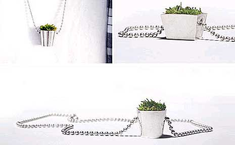 The Growing Jewelry House collection by HAF features a silver ball chain necklace with a potted plant at the end with real growing moss inside.