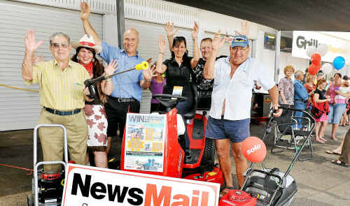 Winner of third prize Merv Cox, Nowa owners Sue and Mark Draganoff, winner of the ride-on mower Rita MacKenzie, NewsMail General Manager Wayne Tomkins and winner of the second prize Richard Gehrmann.