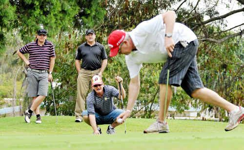 Dean Kronk, Andrew Bainbridge, Mick Kettle and Chris Kettle on the 10th green at the Bargara Golf Club charity day to raise funds for child protection.
