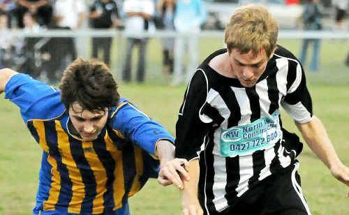 Jay Cooper of Across The Waves and Luke Metcalf of Bingera compete for the ball at Martens Oval.