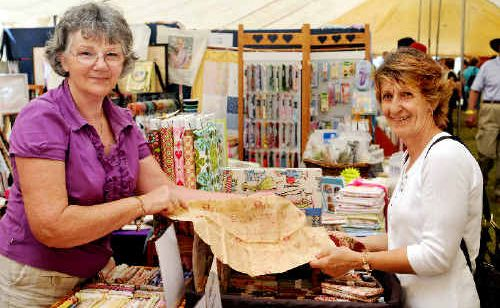 Nimble Stitches' Edna Richardson finds Sandra Bradbury the perfect piece of patchwork fabric at the Fraser Coast Living Expo.