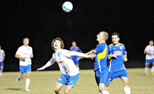 Woombye's Luke Alderson battles Alan Walsh for the ball.